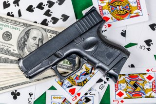 Gun, money and playing cards background